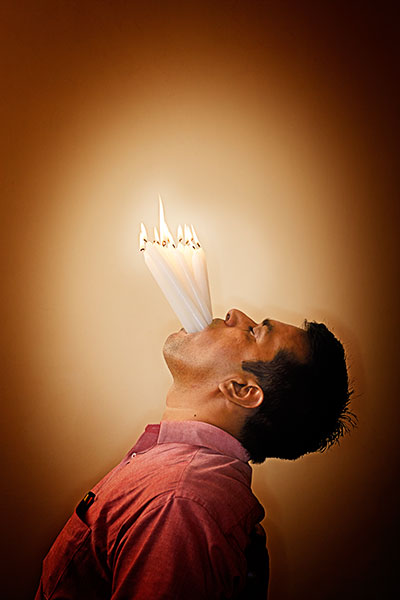 most-lit-candles-in-the-mouth-portrait